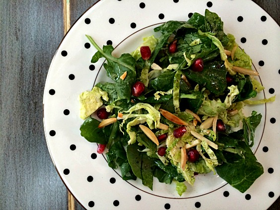 salad with kale brussel sprouts Pomegranate seeds